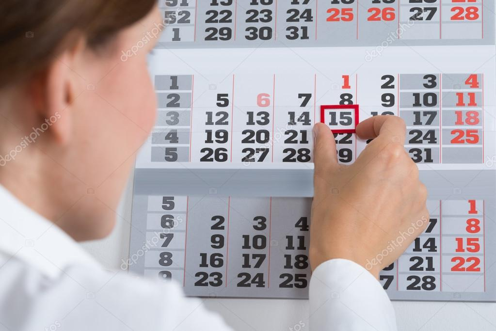 depositphotos 80378300 stock photo businessperson marking on calendar
